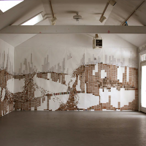 ©Laurie Frick: 45 foot piece from cut cardboard on 3 walls of the Yaddo studio, March 2010