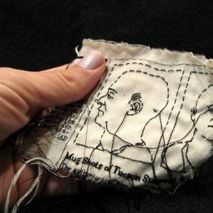 "Lauren DiCioccio, 23FEB11, ""Mug Shots of Tucson Suspect Are Released"", Hand-embroidery on cotton muslin"